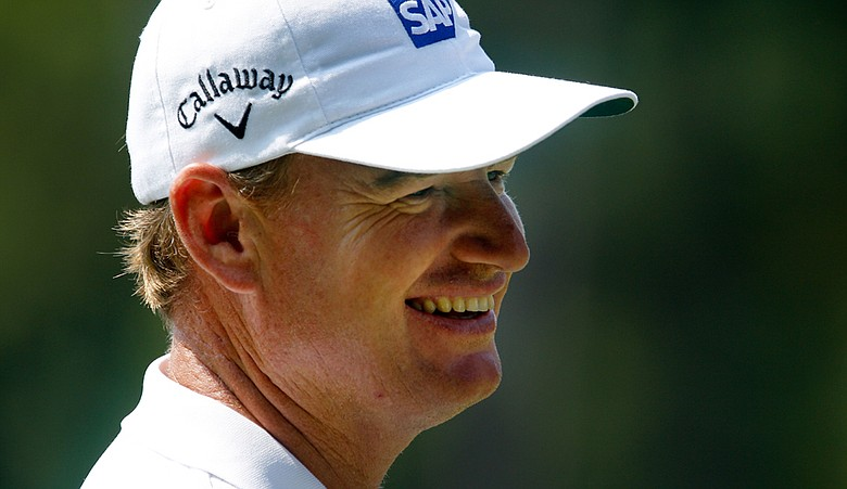Ernie Els smiles while on the practice range prior to playing his first round of the Tour Championship.