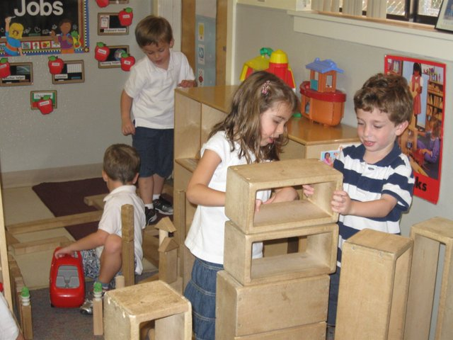 Sam Bermbaum and Kayla Gould, at right, play with big blocks at the JCC's Maitland campus recently. Several Maitland Jewish organizations lost funding this year.