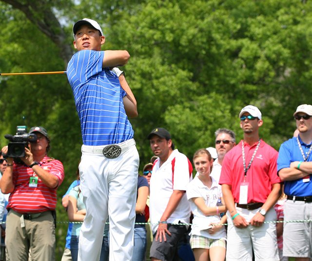 Anthony Kim tees off in front of a crowd at the Houston Open.