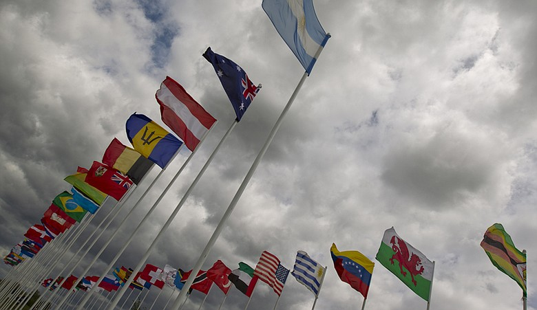 Flags are seen during inclement weather on Saturday at the World Amateur Team Championship.