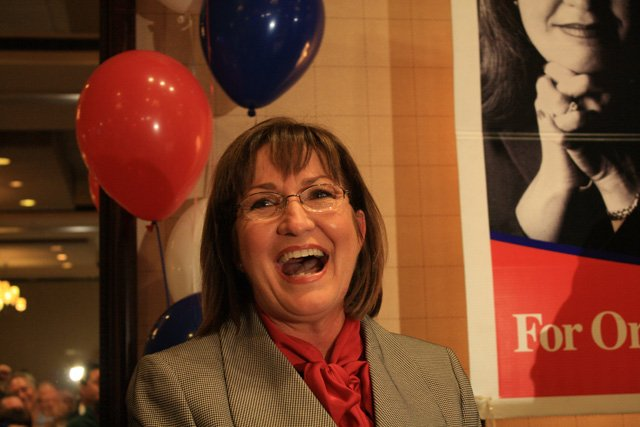 Teresa Jacobs reacts to her win in the Orange County mayor race on Tuesday night at the Sonesta Hotel.