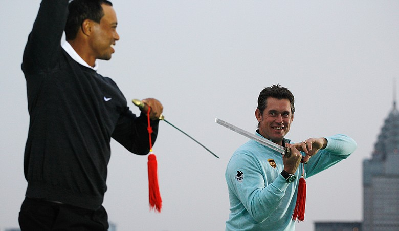 Tiger Woods and Lee Westwood cross swords during the 2010 WGC-HSBC Champions Photocall at The Peninsula Hotel in Shanghai.