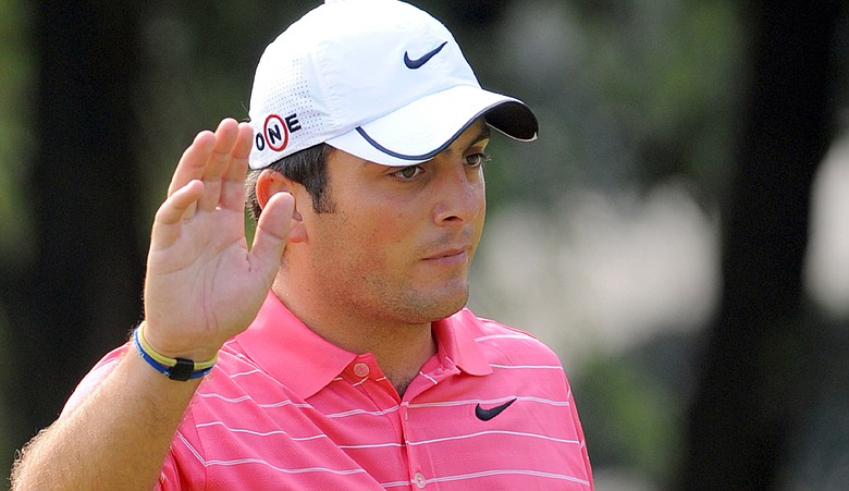Francesco Molinari acknowledges the cheering crowd after a birdie putt during Round 3 of the HSBC Champions.