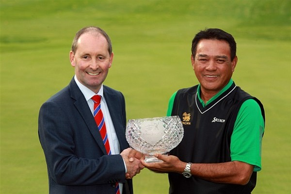 Andy Stubbs, managing director of the European Senior Tour, presents the John Jacobs Trophy to Boonchu Ruangkit of Thailand for being the top money earner in 2010.