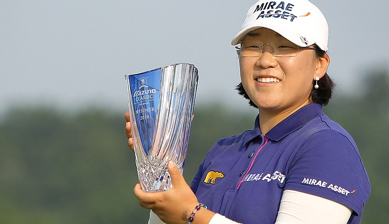 Jiyai Shin poses with the winner's trophy during an award ceremony after winning the Mizuno Classic at Kintetsu Kashikojima Country Club.