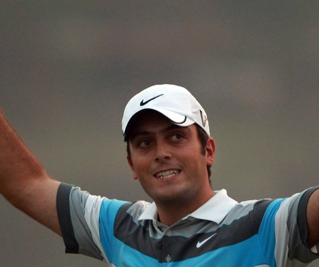Francesco Molinari celebrates on the 18th green after winning the WGC-HSBC Champions.