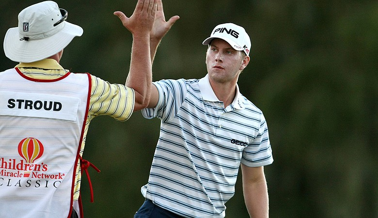 Chris Stroud high-fives his caddie during Round 1 of the Children's Miracle Network Classic.