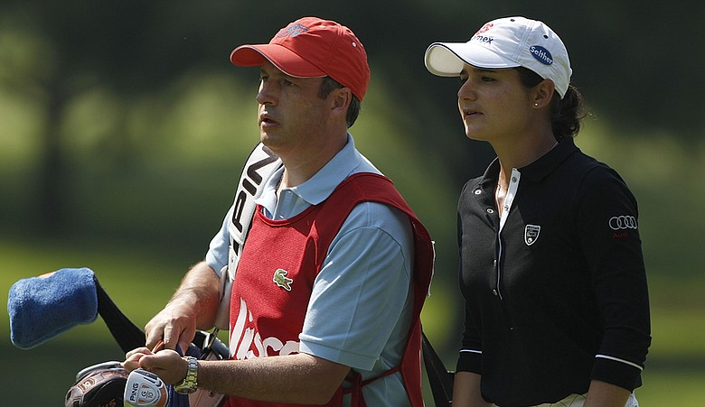 Lorena Ochoa (right) with husband and caddie Andres Conesa