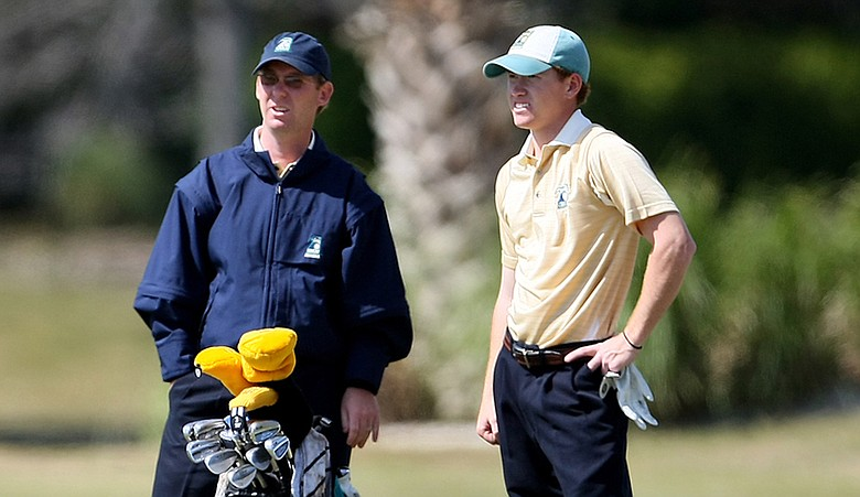 Matt Clark, left, talks with player Taylor Zimmerman during the 2009 John Hayt Collegiate Invitational.