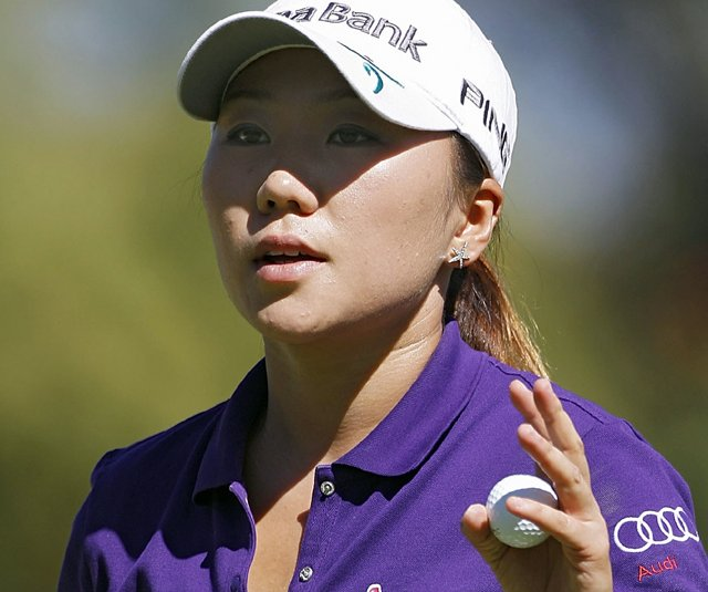 In-Kyung Kim holds up her ball on the fourth green during the third round of the Lorena Ochoa Invitational.
