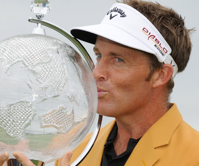 Stuart Appleby holds the trophy after winning the Australian Masters at the Victoria Golf Club in Melbourne.