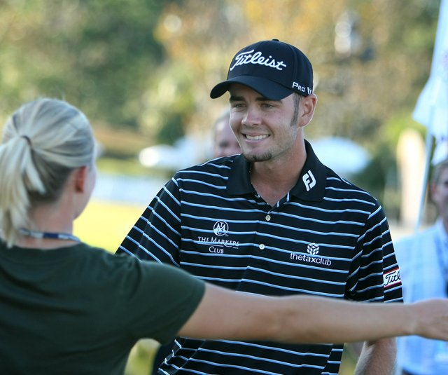 Troy Merritt hugs his wife Courtney after winning the Kodak Challenge in a playoff.