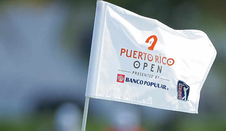 A hole flag flies over the ninth green during the first round of the Puerto Rico Open.