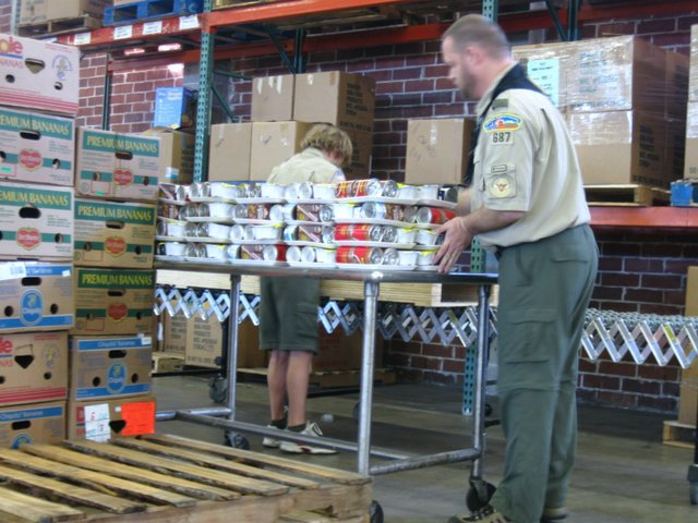 Volunteers shift through and sort donations at Second Harvest Food Bank of Central Florida's warehouse recently.