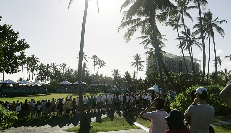 Fans line the 17th green of Waialae Country Club, host of the Sony Open.