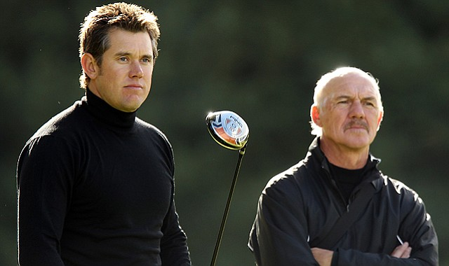 Lee Westwood of England with his coach Pete Cowen during a practice session at the Worksop Golf Club in England.