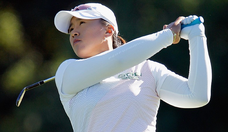 Amy Yang hits her approach shot on the first hole during the first round of the LPGA Tour Championship.