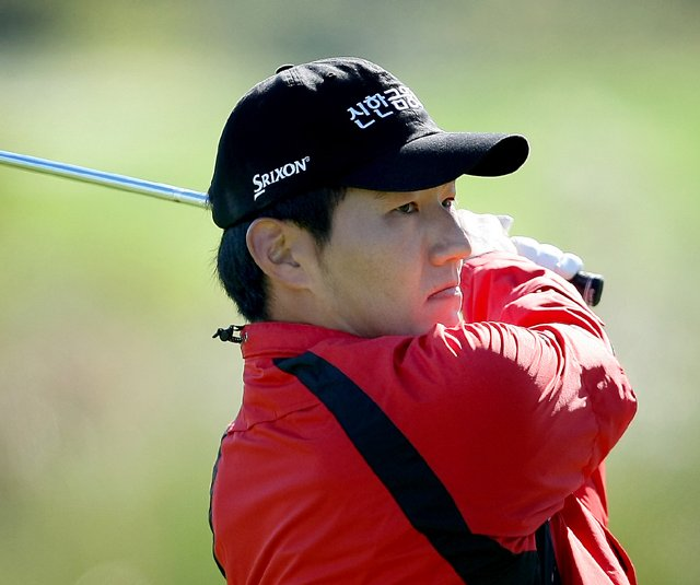 Sung-Hoon Kang hits his tee shot at No. 7 on the Panther Lake course during Thursday&#39;s round of the 2010 PGA Tour Qualifying Tournament at Orange County National.