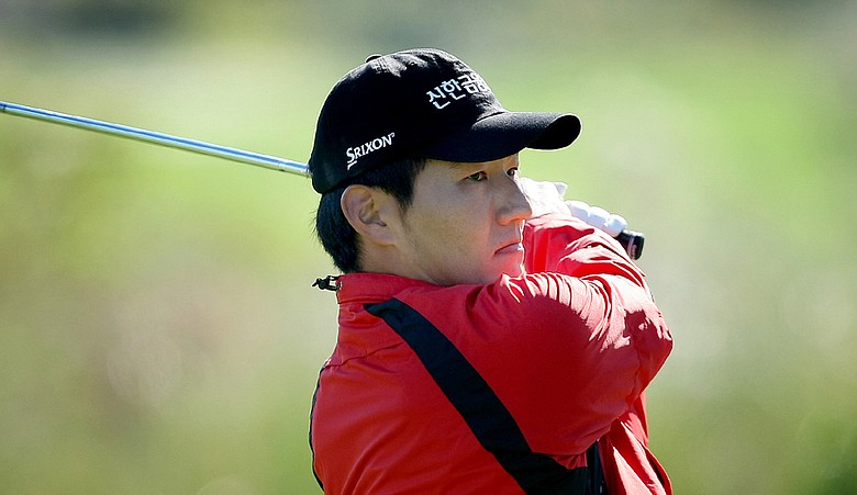 Sung-Hoon Kang hits his tee shot at No. 7 on the Panther Lake course during Thursday's round of the 2010 PGA Tour Qualifying Tournament at Orange County National.