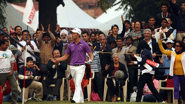 Rikard Karlberg celebrates after chipping in on the 18th to seal victory at the 2010 Hero Honda Indian Open -- his second title of the year.