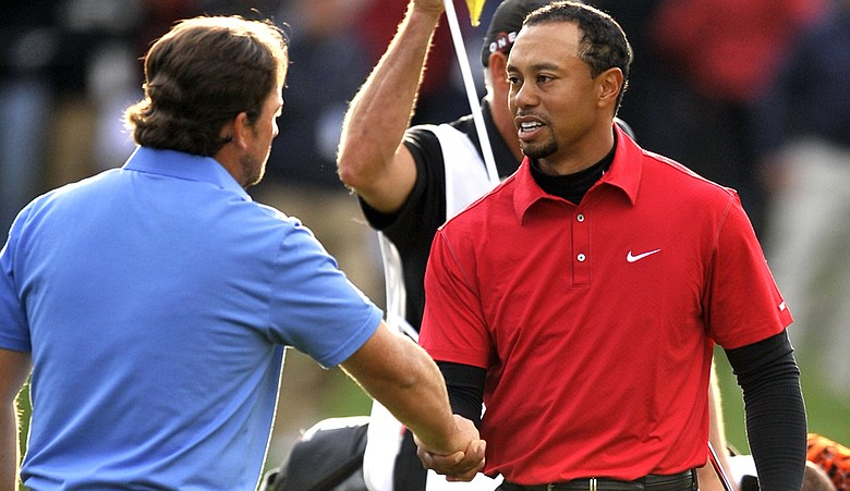 Tiger Woods and Graeme McDowell after the Chevron World Challenge.