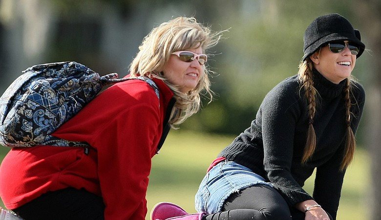 Paula Creamer (right) watches Stephanie Connelly Wednesday with Stephanie's mother, Alicia.