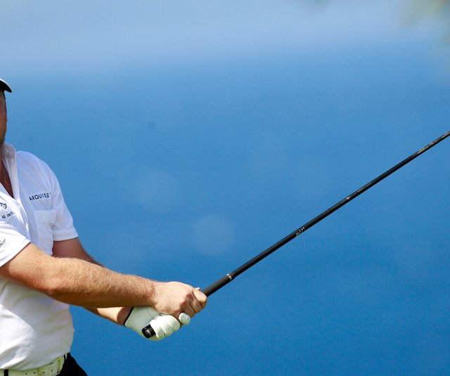 Graeme McDowell of Northern Ireland hits a shot during a practice round prior to the Hyundai Tournament of Champions at the Plantation course on January 4, 2011 in Kapalua, Hawaii.