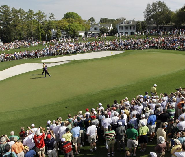 Tiger Woods walks up to the 18th green during the 2010 Masters.