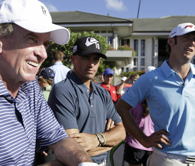 PGA Tour commissioner Tim Finchem, surfer Kelly Slater and Dustin Johnson during the Hyundai Tournament of Champions pro-am at Kapalua. 