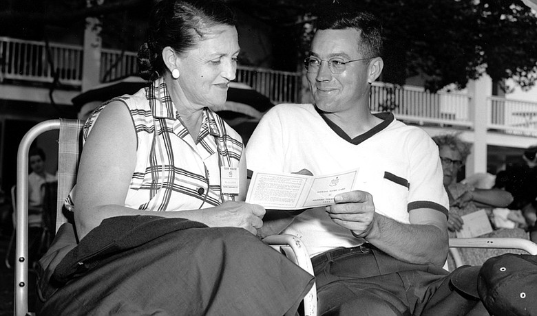 Billy Joe Patton shows the official score card to his mother, Mrs. N.M. Patton, after taking an early lead in the first round of the 1954 Masters Golf Tournament at Augusta National Golf Club.