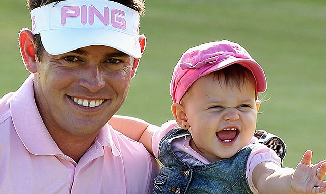 Louis Oosthuizen of South Africa poses with daughter Jana after winning the 2011 Africa Open after a three-way playoff in East London, South Africa.