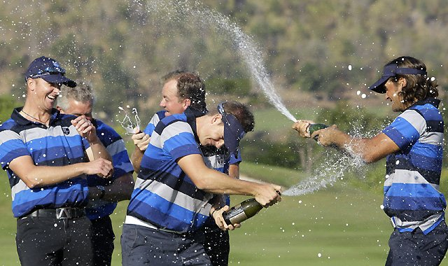 Europe team members, from left, Andersson Fredrik, Colin Montgomerie, Peter Hanson, Henrik Stenson and Johan Edfors celebrate after defeating the Asia team Sunday at the 2011 Royal Trophy matchplay event at the Black Mountain Golf Club in Hua Hin, Thailand.