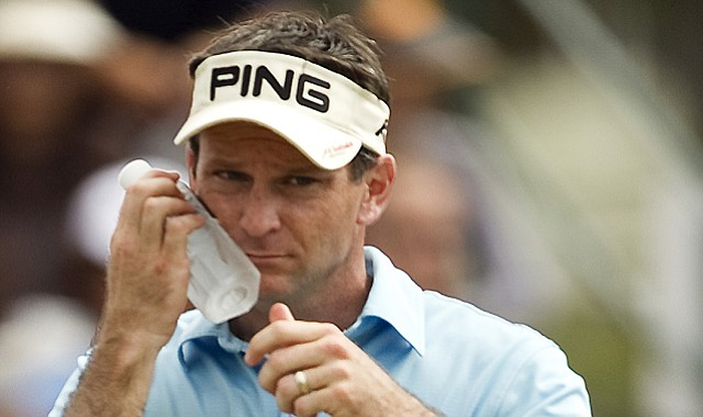 Mark Wilson, who later won, cools off during the final round of the Sony Open, which included 36 holes on Sunday.