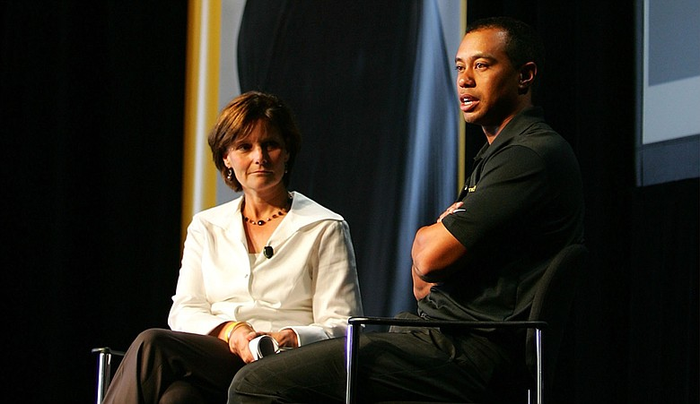 Tiger Woods with Cindy Davis, Nike Golf president, during a press conference for a product promotional tour in 2006.