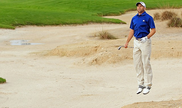 Sergio Garcia of Spain jumps to get a better view on the 18th hole during the pro-am Jan. 26, prior to the start of the Volvo Golf Champions at the Royal Golf Club in Bahrain.
