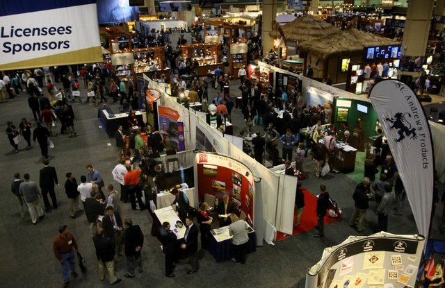 The view from the Osprey Cafe at the Orange County Convention Center shows equipment and apparel booths crowded onto the PGA Merchandise Show floor.