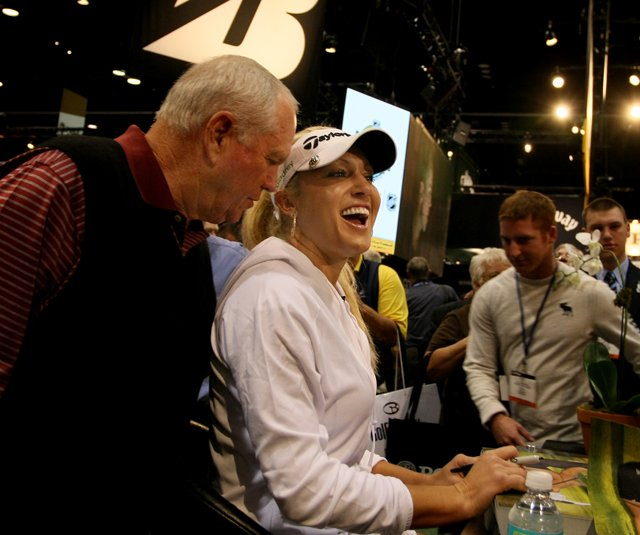 Butch Harmon laughs with Natalie Gulbis during the 2011 PGA Merchandise Show.