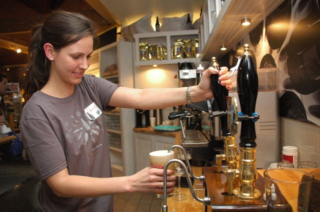 Bartender Amber Leenstra pours an Old Thumper at the Shipyard Emporium during the Maine-based brewery's grand opening on Friday night, Jan. 29, on Fairbanks Avenue. The market and brewhouse offered $2 beers and free samples of their clam chowder and lobster bisque.
