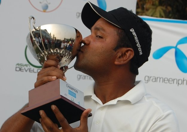 Rahman Siddikur celebrates after his 12-stroke victory in the 2011 Grameenphone Bangladesh Masters.