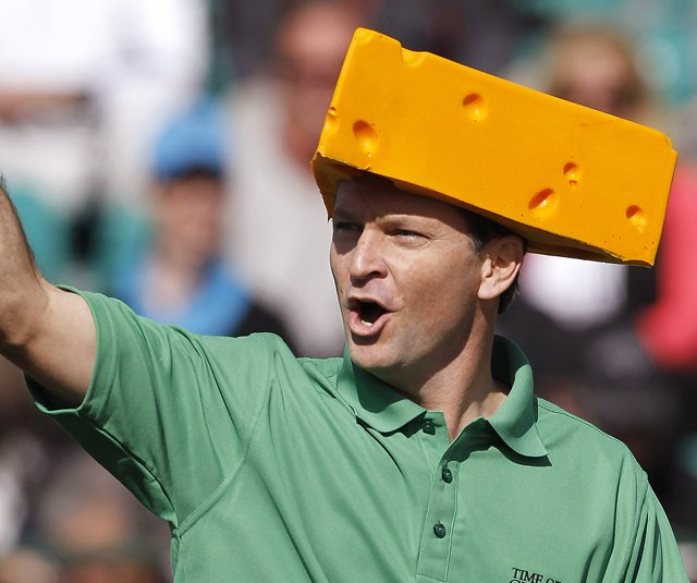 Wearing a Green Bay Packers &quot;cheesehead,&quot; Mark Wilson cheers on the crowd at the 16th hole during the third round of the Waste Management Phoenix Open, which he went on to win in a playoff over Jason Dufner.