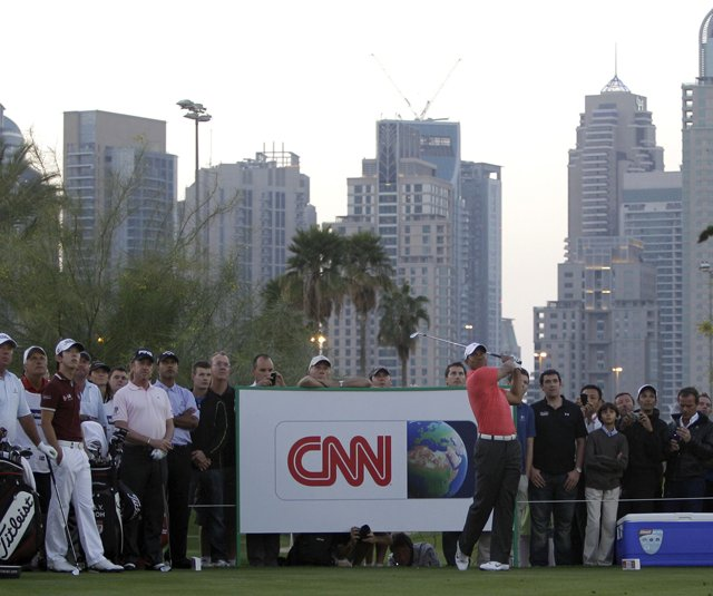 Tiger Woods plays a shot during a practice round in advance of the Dubai Desert Classic.
