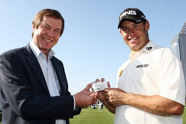 Lee Westwood receives his Honorary Life Membership Card from Tour Chief Executive George O'Grady.