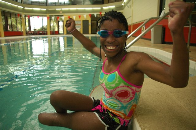 Twelve-year-old Elizabeth Dax swims at Crosby YMCA in Winter Park on Saturday morning with her 'foster grandmother' Cheryl Eller, who lives in Winter Park. Three days later, she was back in her country of Namibia, where her foster mother lives.