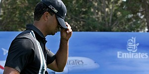 Woods struggles in opening round in Dubai