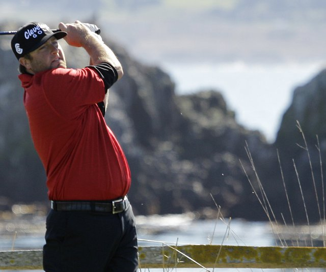 Steve Marino follows his drive from the 18th tee of the Pebble Beach Golf Links during the second round of the AT&T Pebble Beach National Pro-Am.
