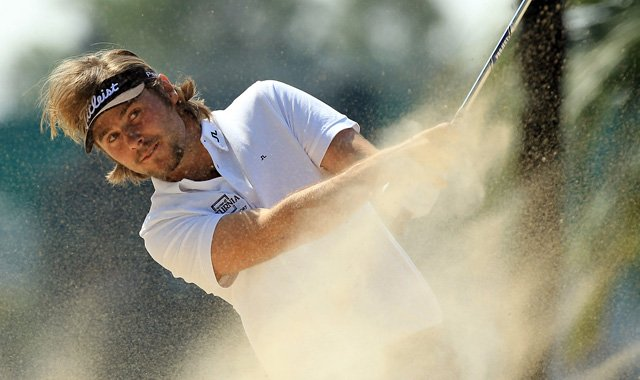 Victor Dubuisson of France plays his second shot at the first hole during the third round of the 2011 Omega Dubai Desert Classic.