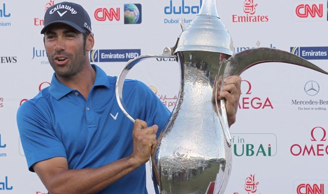 Alvaro Quiros of Spain poses after winning the 2011 Dubai Desert Classic for his fifth European Tour title.