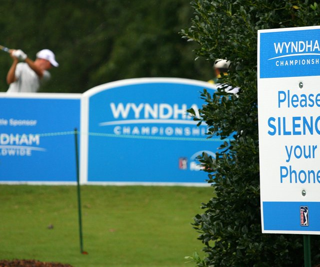 A sign asking for fans to silence their cell phones next to the 15th tee during the 2010 Wyndham Championship.