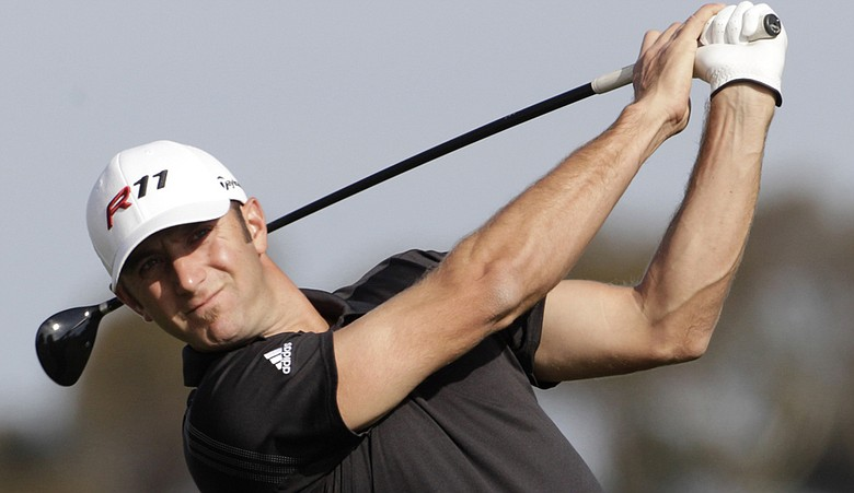 Dustin Johnson hits a shot during the Farmers Insurance Open.