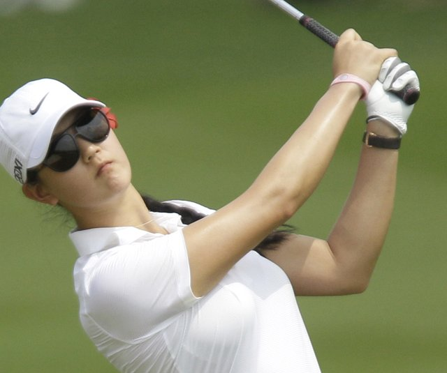 Michelle Wie of the U.S. hits the ball from fairway on the 1st hole during the second round of LPGA Thailand golf tournament in Pattaya, southern Thailand Friday, Feb 18, 2011.